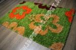 яркий зеленый длинноворсный ковер с цветами