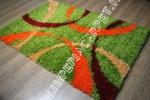 зеленый яркий ковер с оранжевыми разводами фото